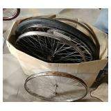 Boxful of bicycle wheels and tire tubes