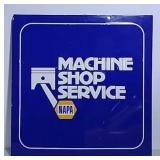 SST Embossed Napa Machine Shop Service sign