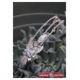 Headpiece Bridal tiara by Symphony Bridal.