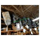 50+/- Assorted Oil Pans Hanging From Rafters
