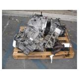PALLET WITH 3 KIA TRANSMISSIONS & EXHAUST