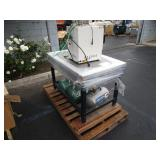 A PALLET WITH STAINLESS STEEL TABLE,