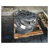 A PALLET WITH EXTENSION CORDS