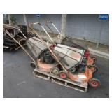 PALLET WITH 4 LAWN MOWERS
