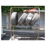 TIRE RACK WITH 4 TOYOTA TIRES & RIMS