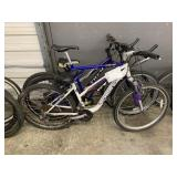LOT WITH 3 BICYCLES: WHITE SCHWINN, BLUE GT, PURPL