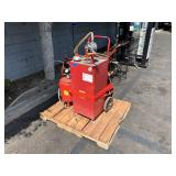 PALLET WITH 30 GAL BIDIRECTIONAL HAND OIL PUMP &