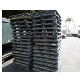 STACK OF PLASTIC PALLETS