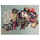 1 BAG WITH JEWELRY, PINS