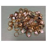 1 BAG WITH GOLD TONE RINGS