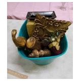 Basket of gold-tone decor items