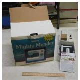 White Mighty Mender portable sewing machine