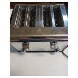 4 slot toaster. Has cancel, bagel and defrost