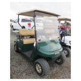 Green EZ Go Golf Cart
