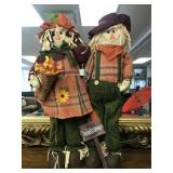 Two Outdoor Scarecrows