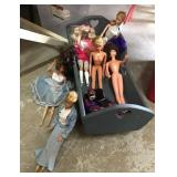 Selection of Barbies and Doll Cribs