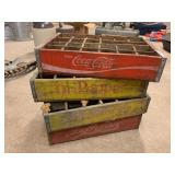 Three Dr. Pepper Crates and One Coca-Cola
