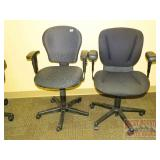 Two Black Fabric Adjustable Office Chairs