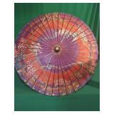 Decorative umbrella. Has hole in top