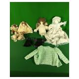 Dolls, stuffed bears, and crocheted baby clothes