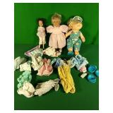 Dolls and assorted clothes
