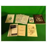 Assorted sheet music, books, and menus