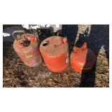 Three metal gas cans