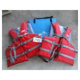STEARNS FLOTATION DEVICE AND ADULT LIFE JACKETS