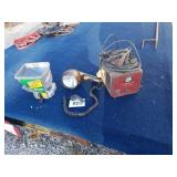 Market battery charger works hands spread or