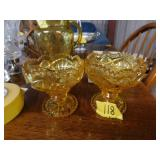 pair of yellow glass bowls
