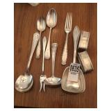Monogramed silverware and napkin holders
