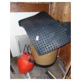 Rubber Mats and Cardboard Barrel on Wheels Gas