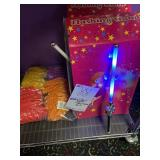 (2) Boxes of light up wands with a bag of rubber b