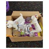 box of goodie bags and stuffed dogs