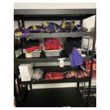 metal shelf with contents of shirts and balloons e