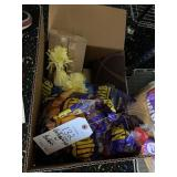 box of balloons with balloon weight holders