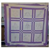 White & lavendar quilt