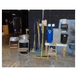 assorted brooms, trash cans