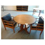 round table and two chairs leather cushions