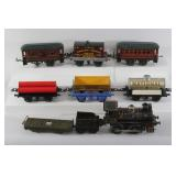 #705 9 pc. Hornby tin train lot