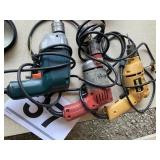 Dewalt (2) and a Milwaukee electric drills