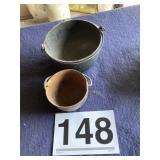 Two cast iron pots