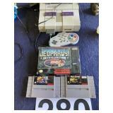 Super Nintendo w/games and controler
