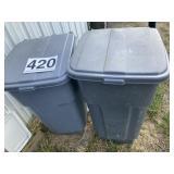 Two Trash Bins on wheels 50 gal