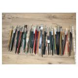 Large Assortment Of Paint Brushes.