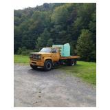 1988 GMC flat bed truck w/ water tank mileage is