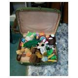 Vintage suitcase full of various stuffed animals
