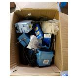 Box full of electrical supplies, plug ins,