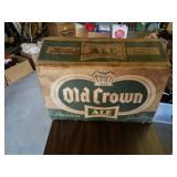 Old crown ale box and 11 empty bottles