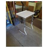 Portable white table and is adjustable